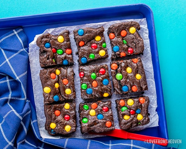 9 M&M Brownies on a blue background