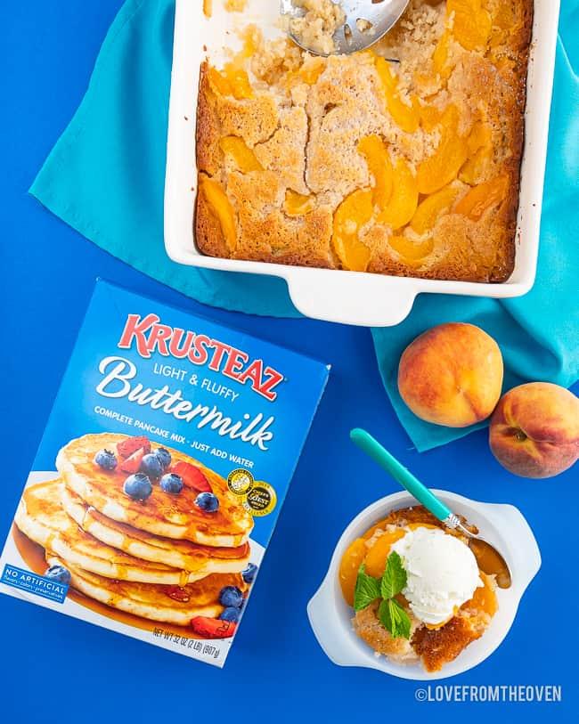 a peach cobbler, peaches and a box of Krusteaz