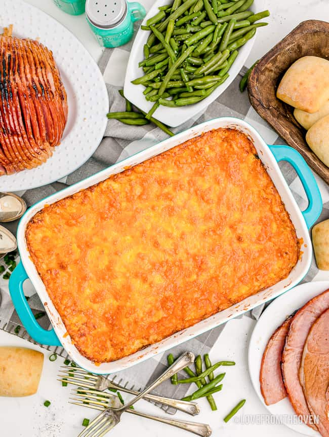 A cheesy casserole on a table with food