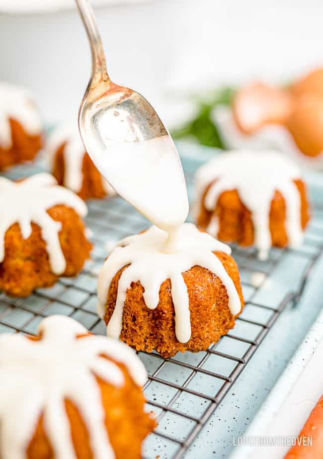 frosting being put on mini bundt cakes