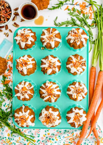 little carrot cakes on a aqua colored pan