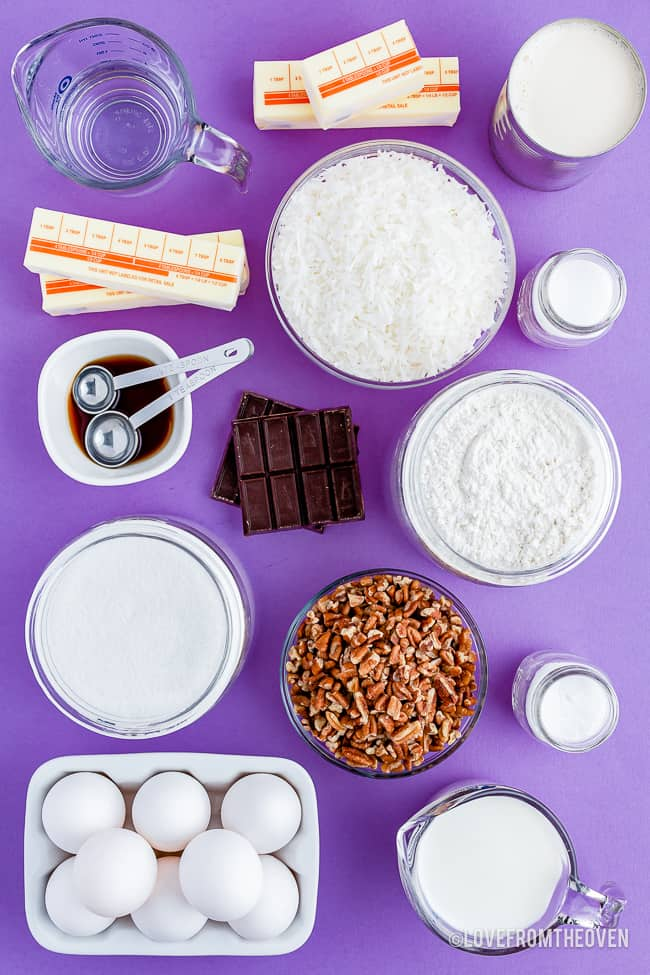 The ingredients for a bakers german chocolate cake laid out on a purple background