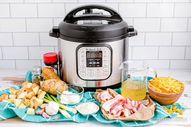 An instant pot and ingredients to make cheesy potatoes