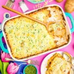 Scalloped potatoes on a pink background