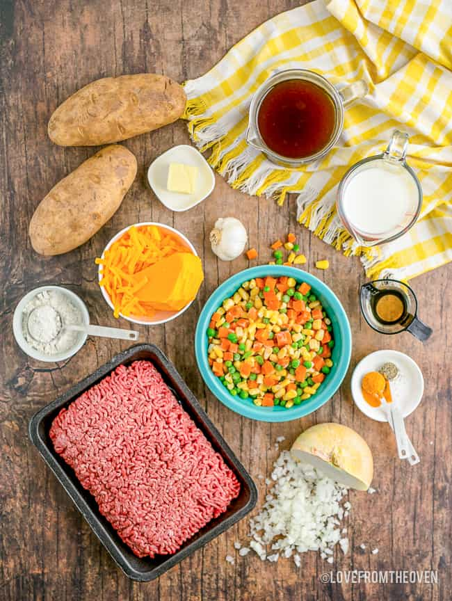ingredients for shepards pie on a wood background