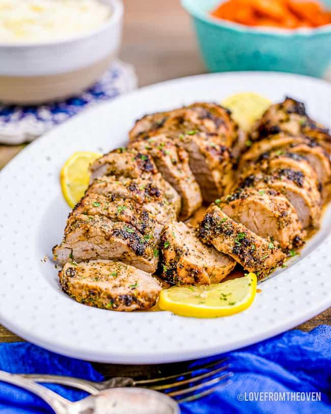 a platter of pork tenderloin