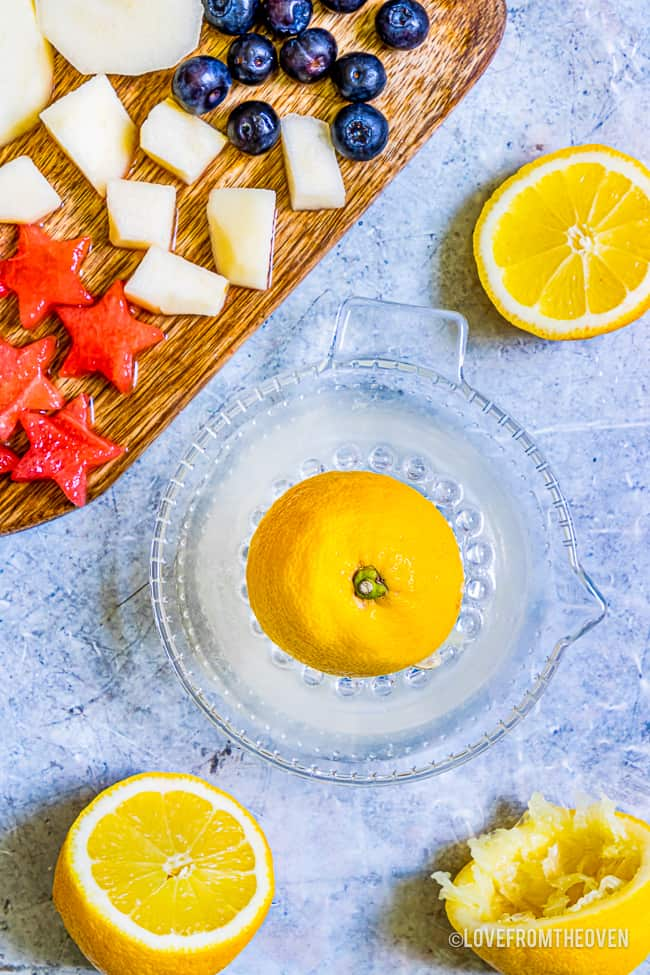 a lemon being juiced