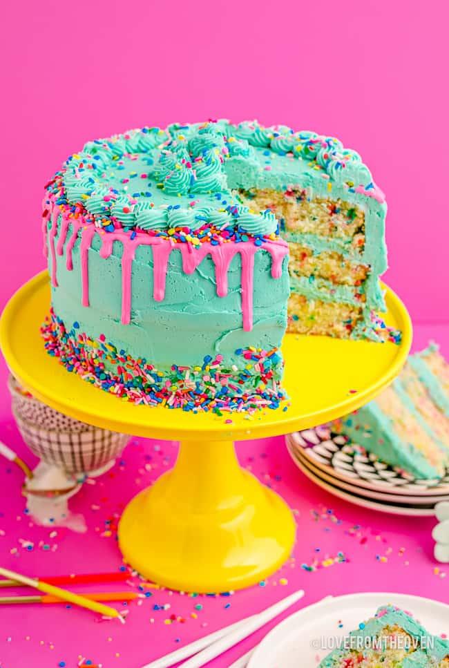 a funfetti cake on a cake stand