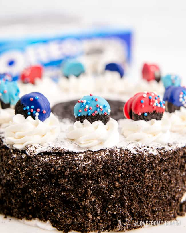 red and blue dipped oreos on a cake