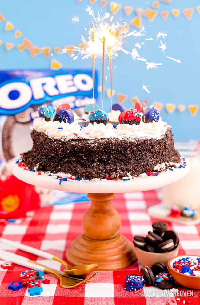 An oreo ice cream cake with sparklers on top.