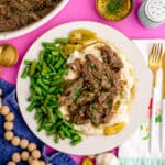 a plaste with Mississippi pot roast, potatoes and green beans