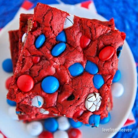 A stack of red white and blue cookie bars.