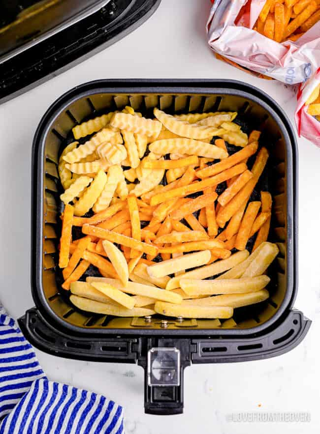 Frozen french fries in an air fryer.