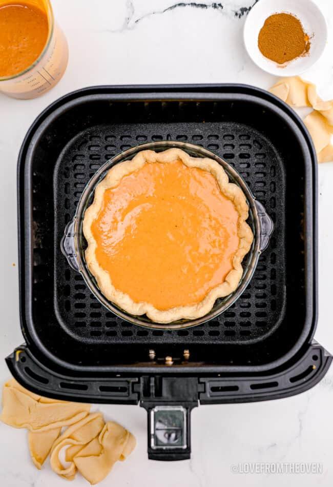 A pumpkin pie in an air fryer.
