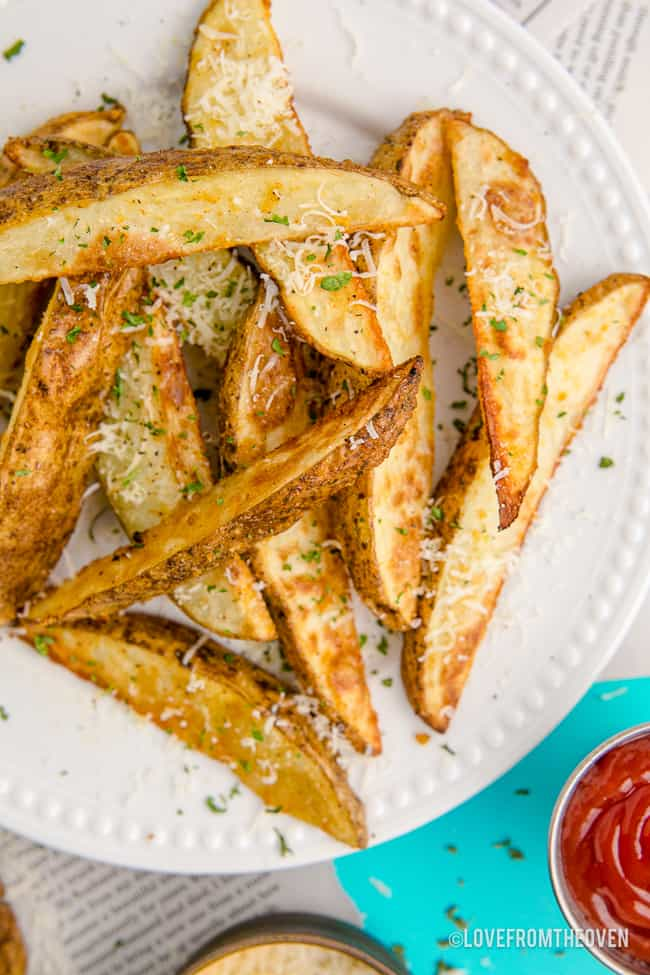 A plate full of potato wedges.