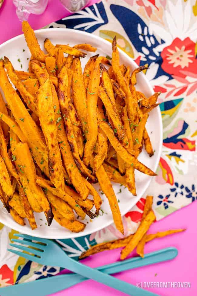 a plate full of sweet potato fries.