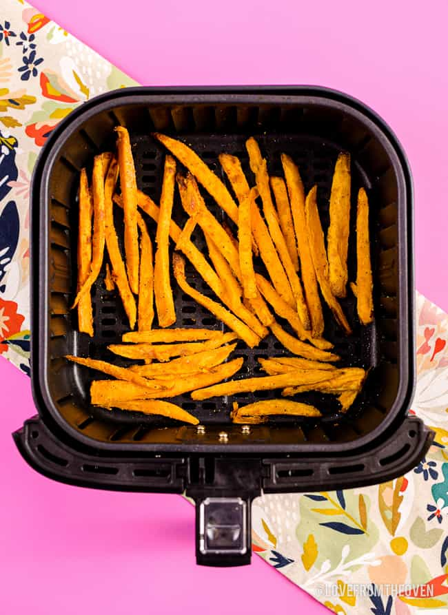 Air Fryer with sweet potato fries in it.