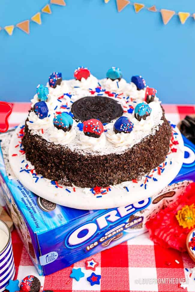 An oreo ice cream cake with red white and blue oreos and decorations.