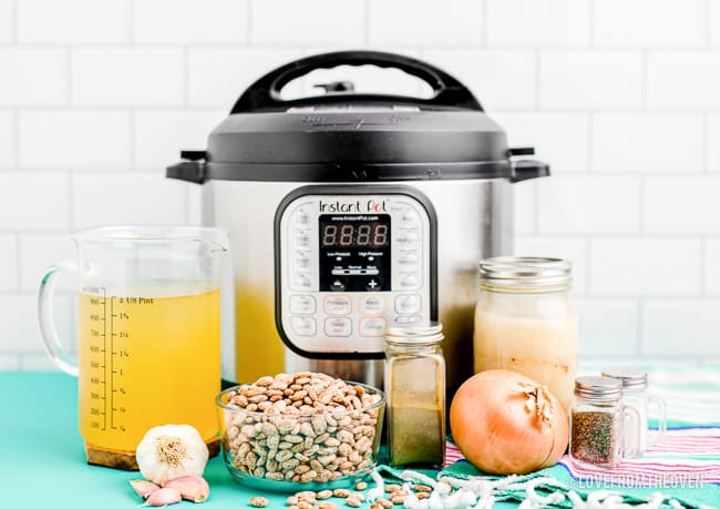 An instant pot with the ingredients to make refried beans.