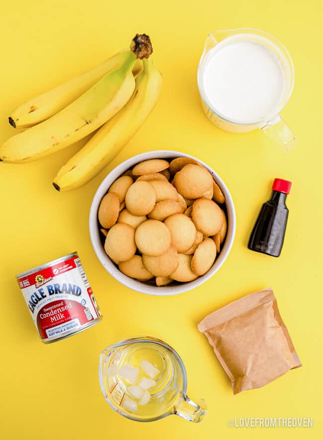 Ingredients to make Magnolia bakery banana pudding, on a yellow background.
