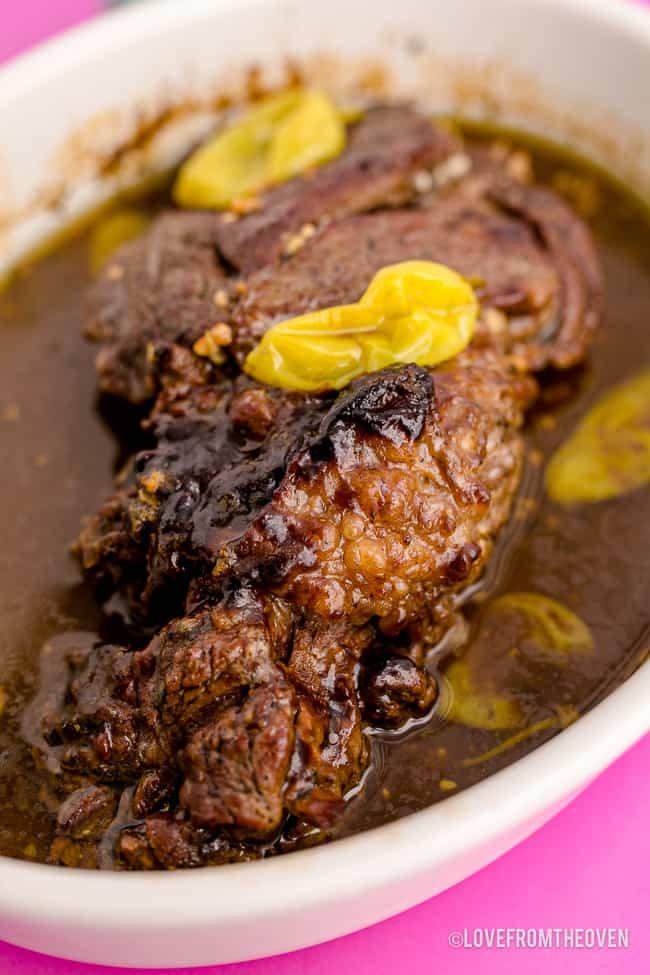 A pot roast in a white dish