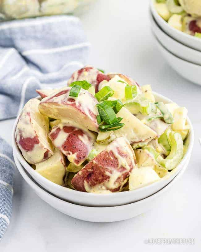 Old Fashioned Potato Salad in a white bowl.