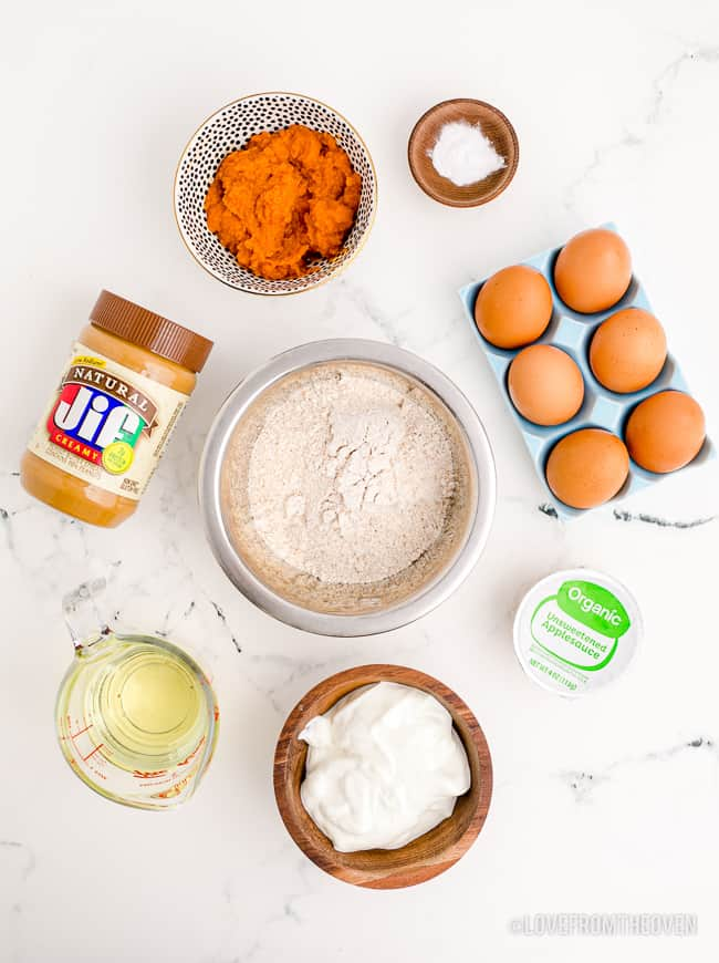 Ingredients to make a dog cake on a white background.