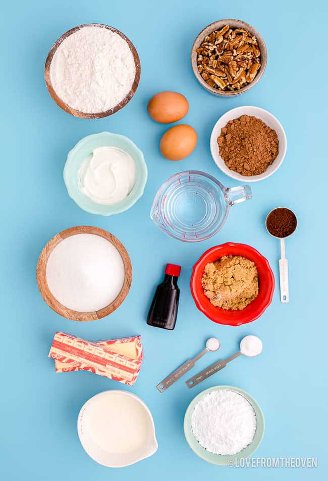 Ingredients for Texas sheet cake on a blue background.