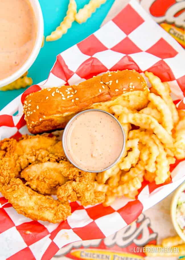 Canes sauce with chicken and fries.