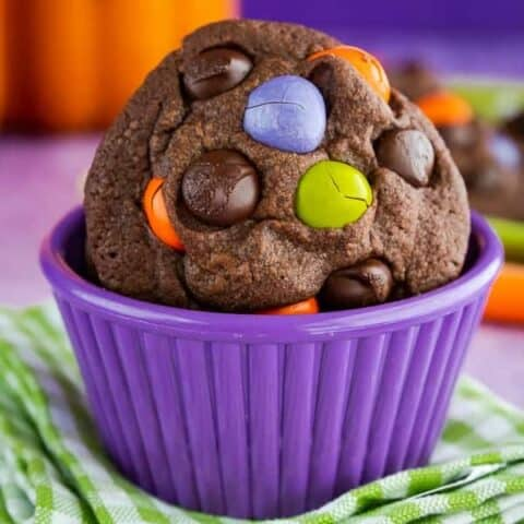 Halloween cookies in a purple bowl.