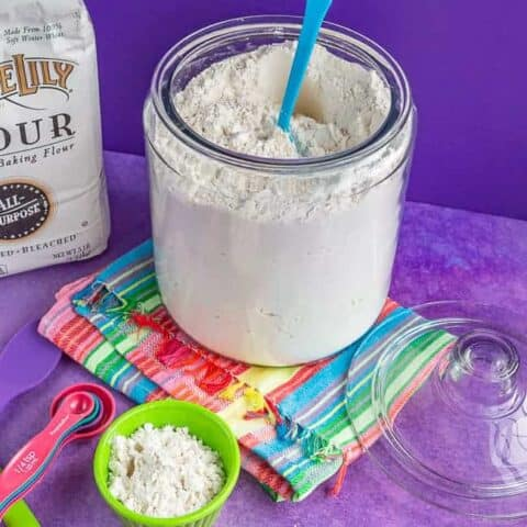 A glass container filled with flour.