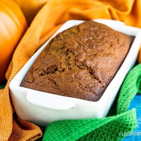 Pumpkin bread in a white bread pan.