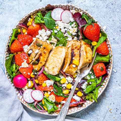A bowl of strawberry chicken salad