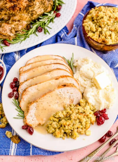 Slices of turkey on a plate with sides and gravy.